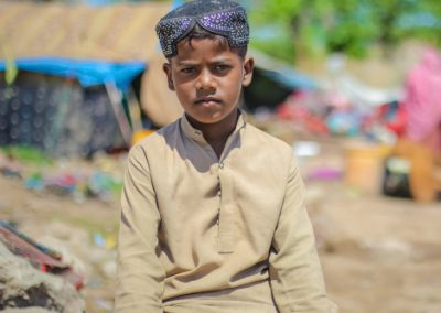 "Slum kid wearing a typical ""Sindhi Topi"""
